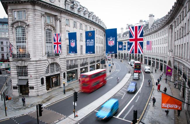 EDITORIAL USE ONLY American NFL (National Football League) flags are displayed above Regent Street, central London, in preparation for NFL on Regent Street - the traffic free event on Saturday 28th September ahead of the NFL's forthcoming International Series in London. PRESS ASSOCIATION Photo. Picture date: Monday September 23, 2013. Regent Street will be traffic free on Saturday 28th September to kick start NFL's International Series preceding the NFL game between the Minnesota Vikings and Pittsburgh Steelers at Wembley on Sunday 29th September. Photo credit should read: John Phillips/PA