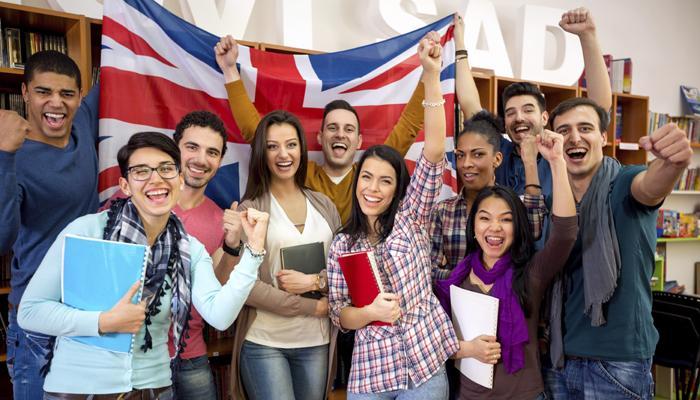Cheerful British students celebrate victory