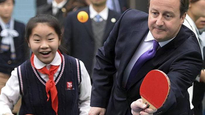 British Prime Minister David Cameron plays table tennis during his visit to a primary school in Chengdu in southwest China's Sichuan province, Wednesday Dec. 4, 2013. (AP Photo) CHINA OUT